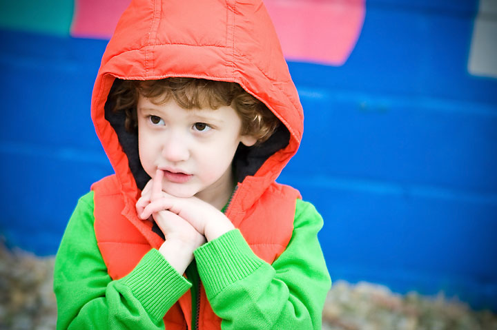 boy in front of colorful wall