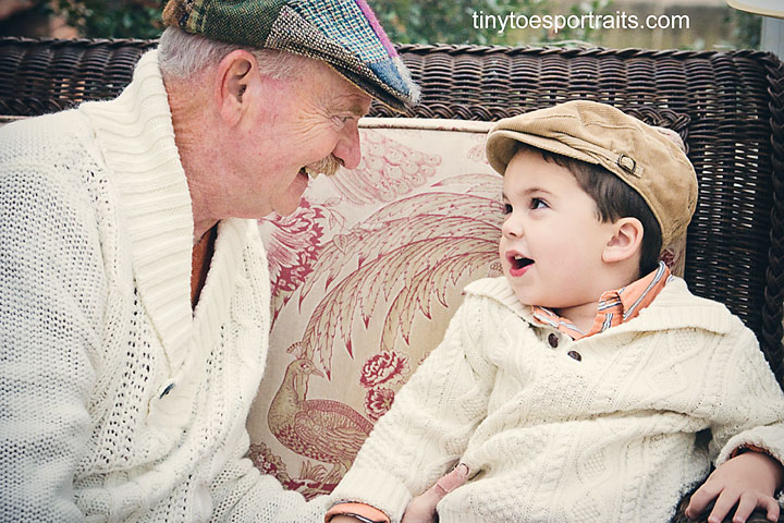 photo of a boy sharing a moment with his grandpa