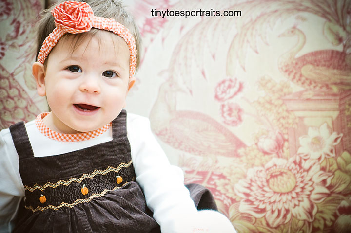 picture of 9 month old girl smiling