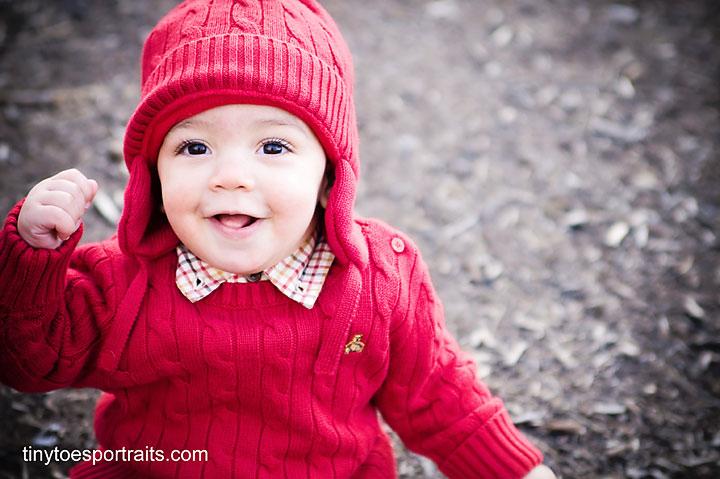 baby boy smiling at camera