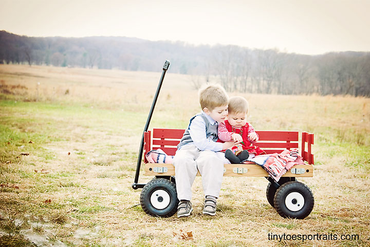 boy and girl in a wagon