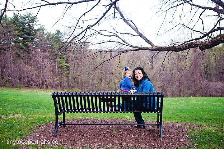 little girl and mommy on bench