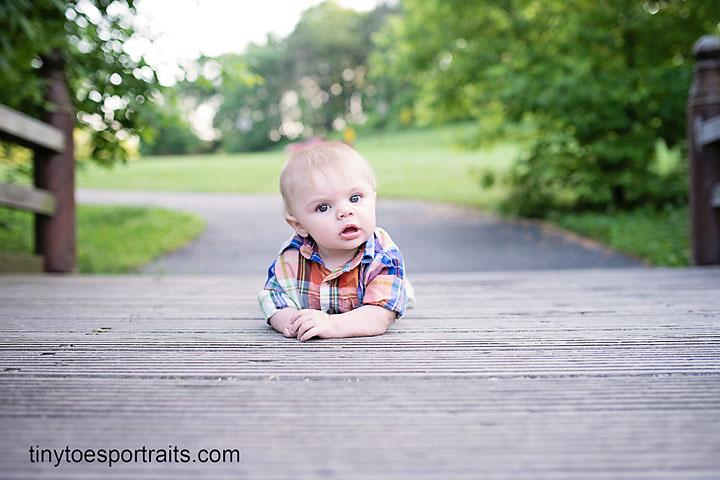 baby boy on bridge