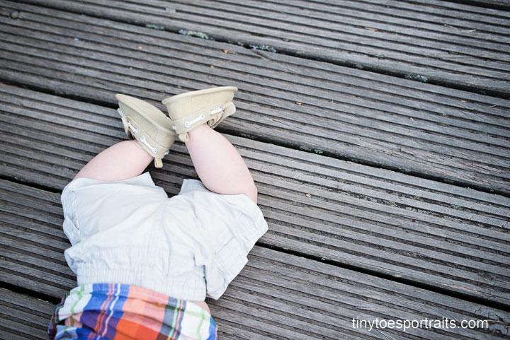 baby boy feet on bridge