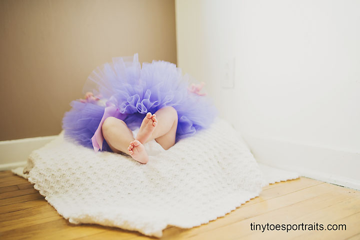 baby girl feet with tutu