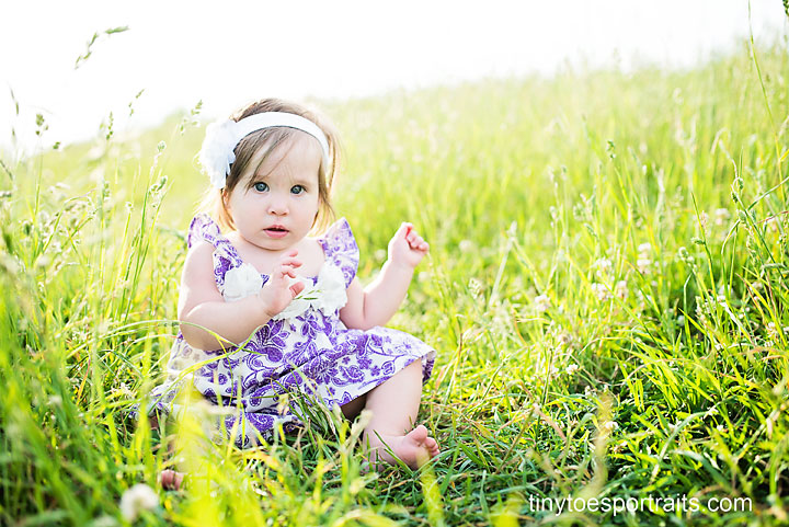little girl in field serious face
