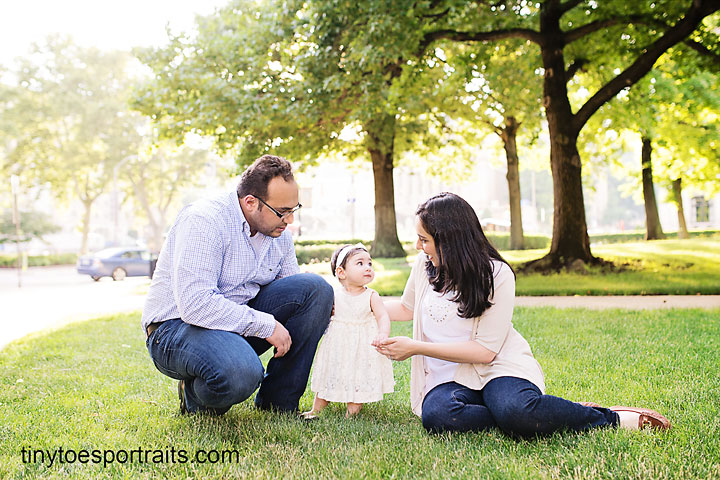 baby girl with parents on lawn