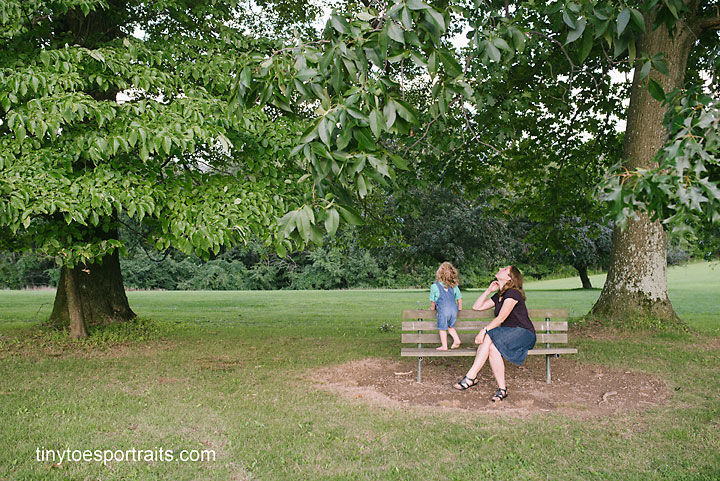 boy and mom sitting on bench