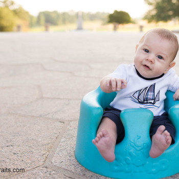 baby boy in blue bumbo