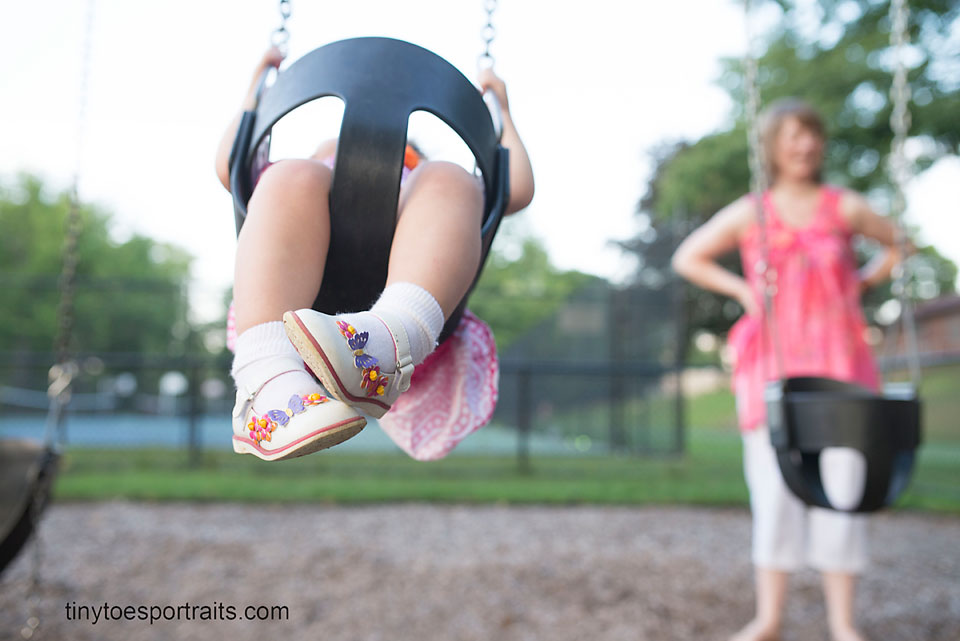 little girl feet on the swing