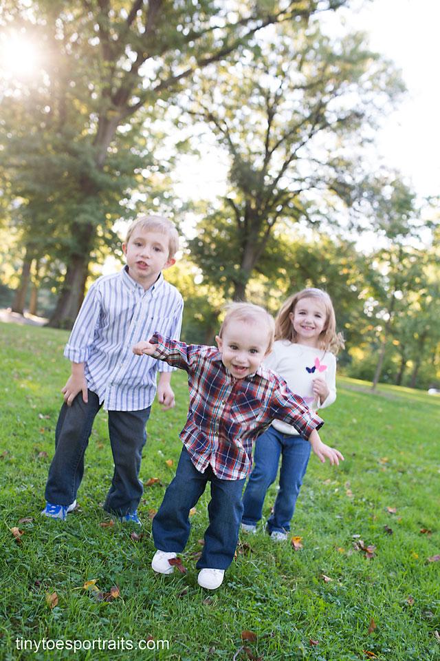 three siblings jumping around