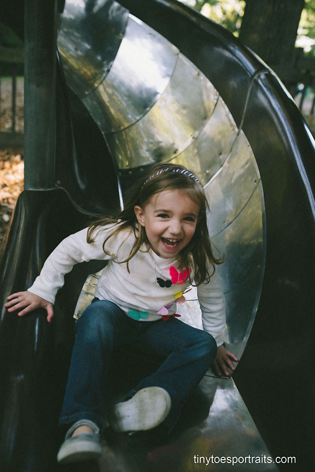 little girl going down a slide