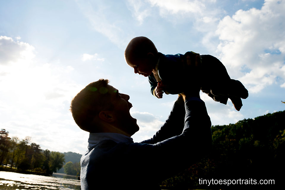 silhouette of dad with baby boy