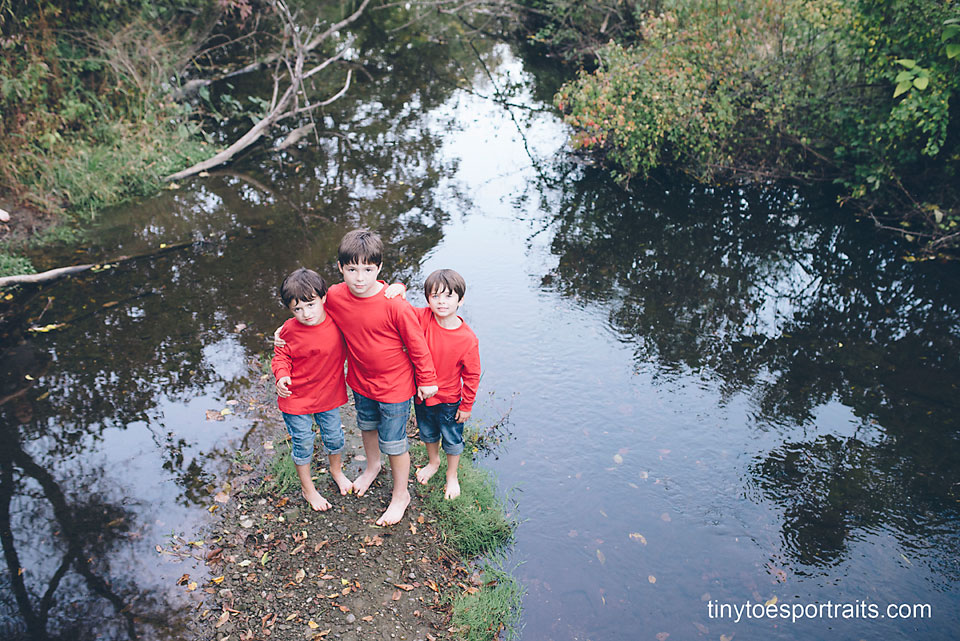 three boys in the creek from above