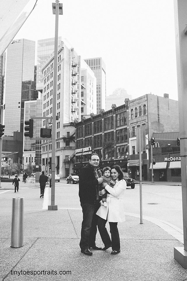 black and white photo of a family in the city