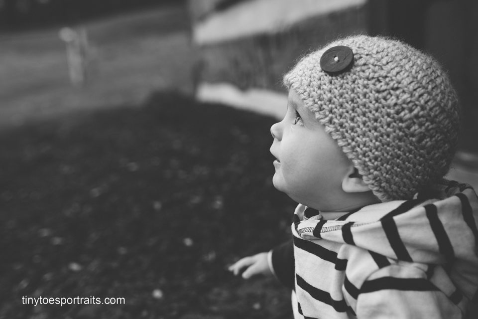 profile of baby boy in black and white