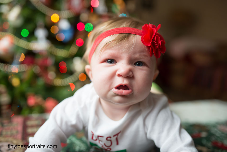 baby girl making a sad face