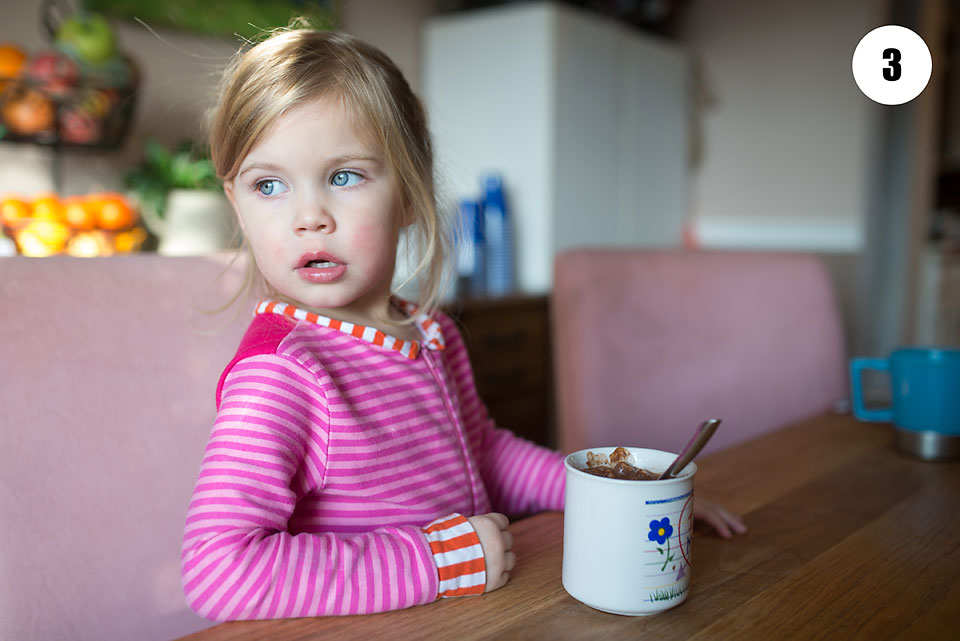 little girl with hot chocolate