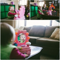 baby girl playing with a toy mirror