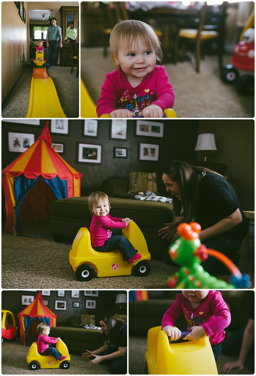 baby girl playing on her toy car