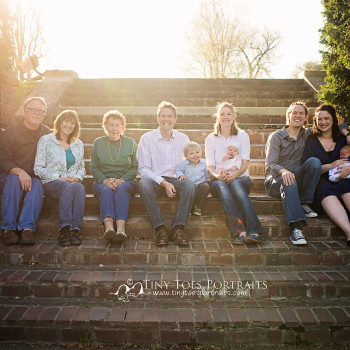 large family sitting on the steps side by side