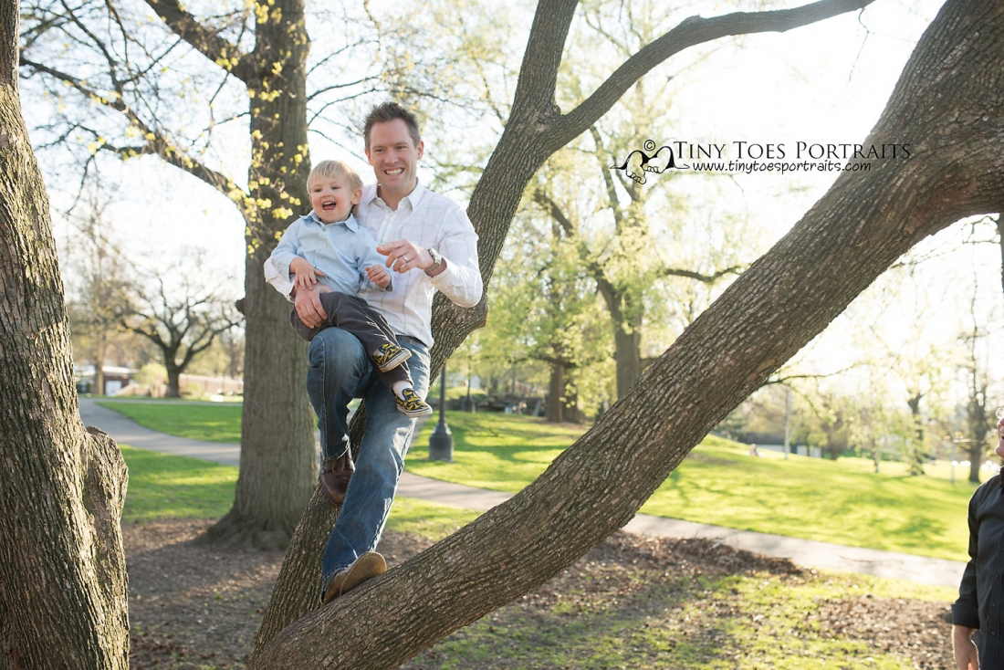 dad and son playing in a tree