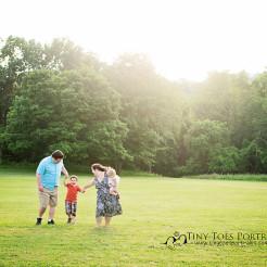 family of four walking in a field