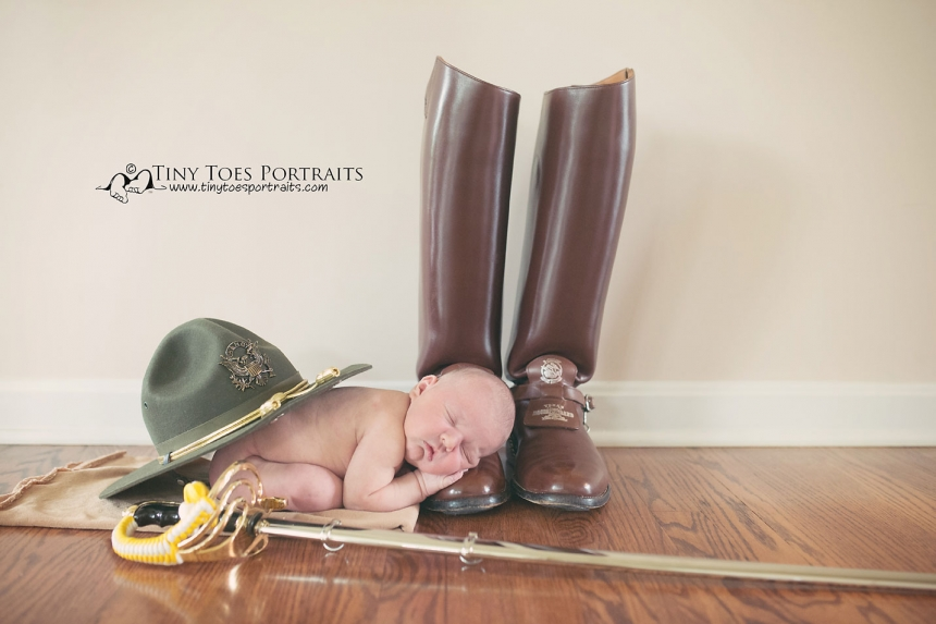 newborn boy with texas a&m props