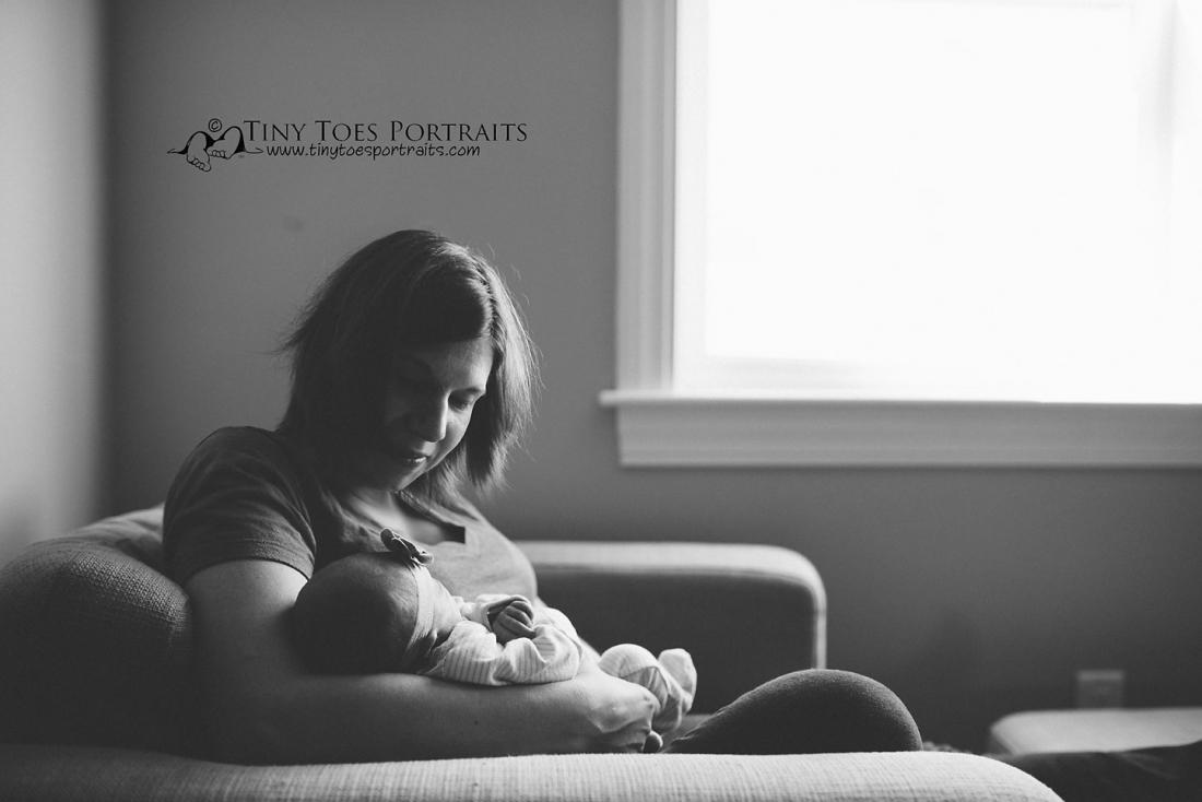 newborn girl being held by her mom