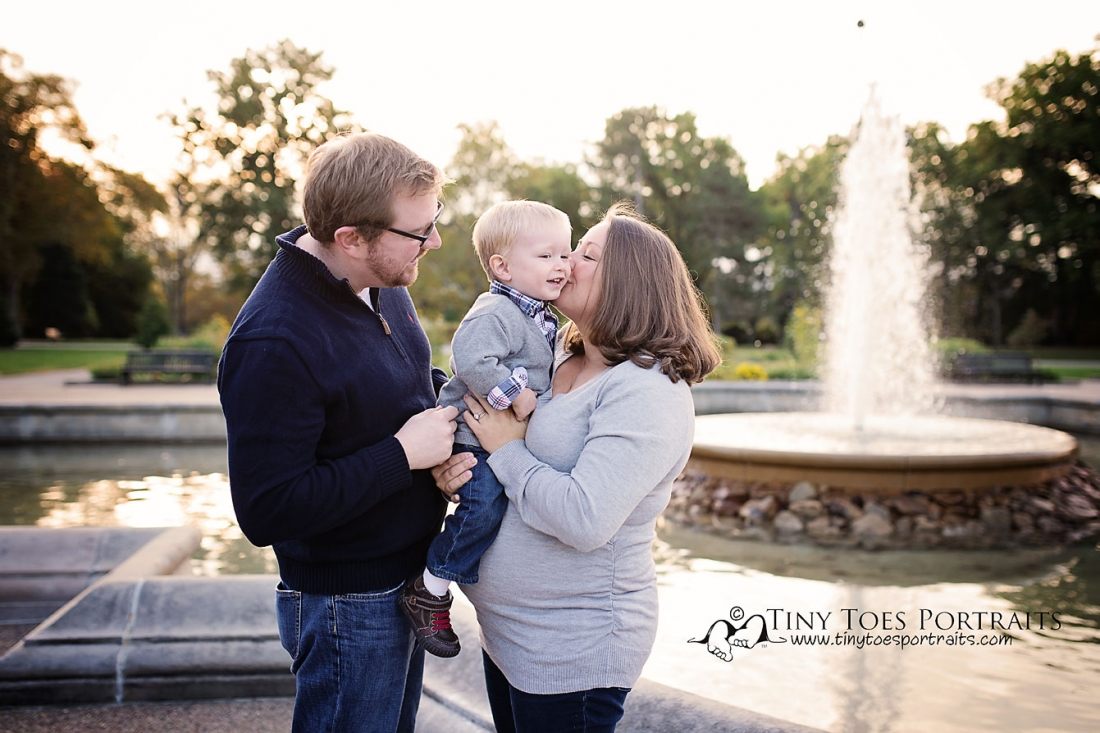 family of three by the fountain in highland park