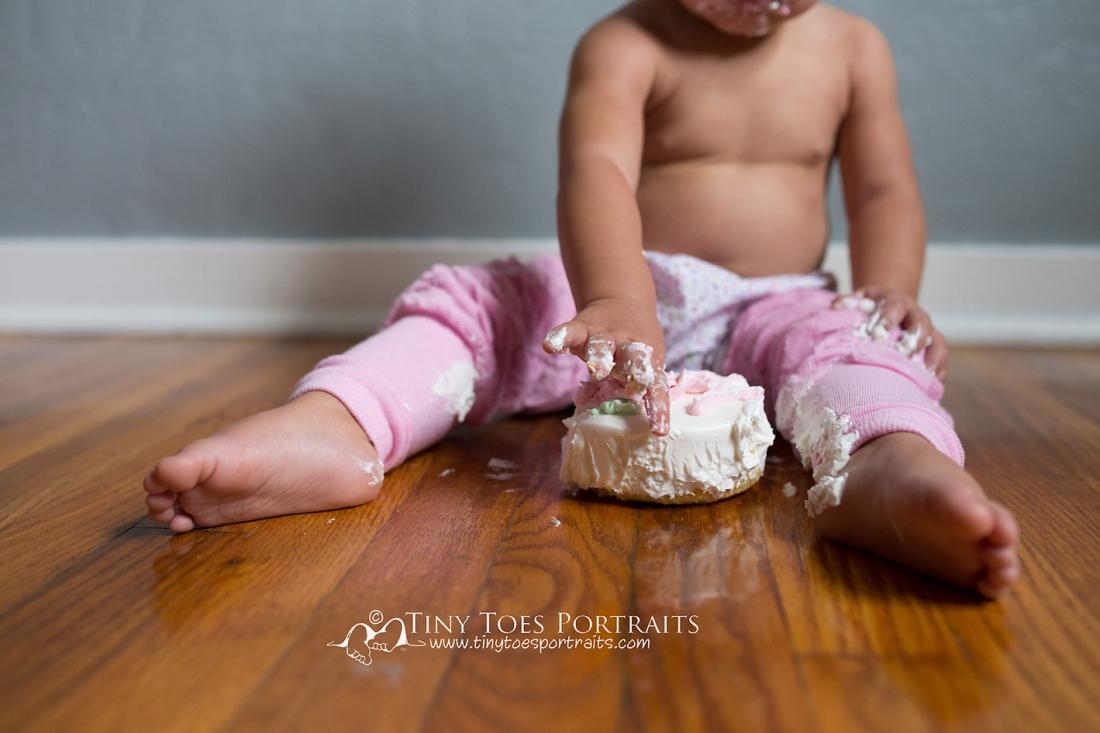 baby girl feet in a cake smash