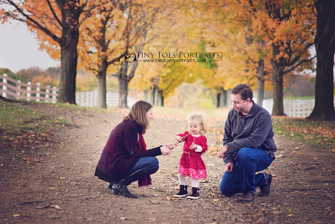 little girl playing with her parents