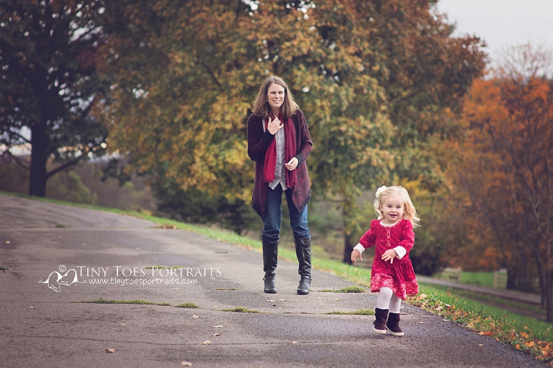 little girl happily running from her mom