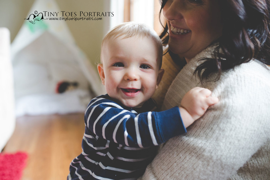 baby boy smiling with mom