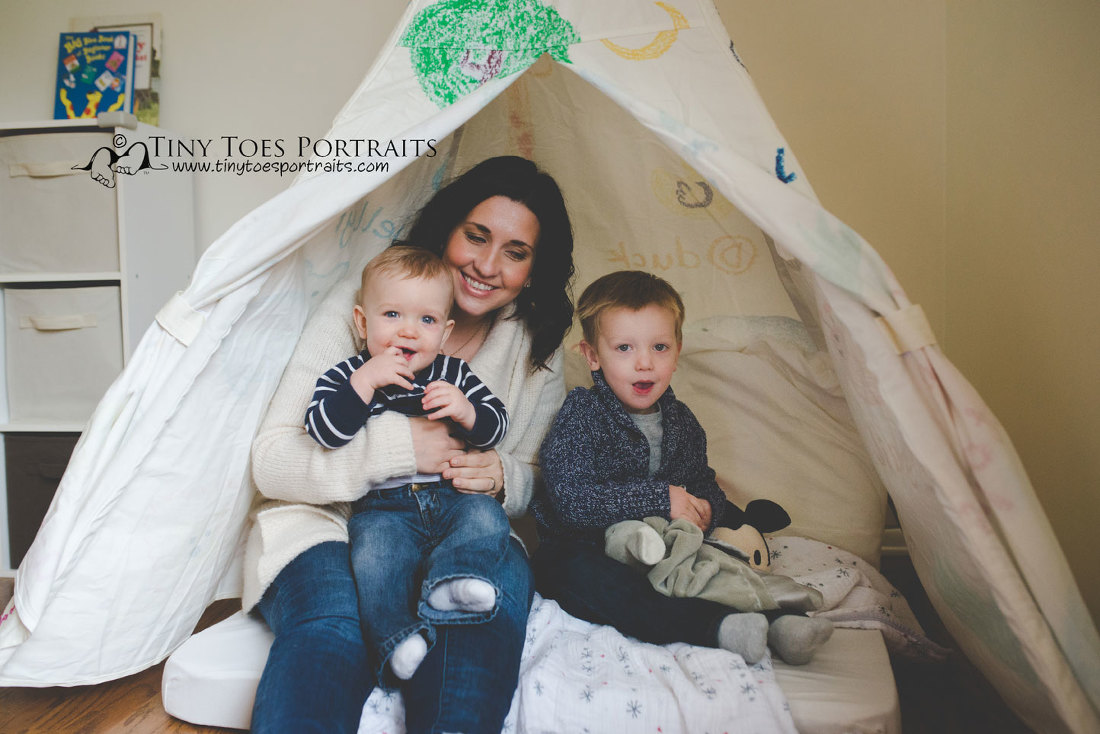 mom and her boys in the play tent