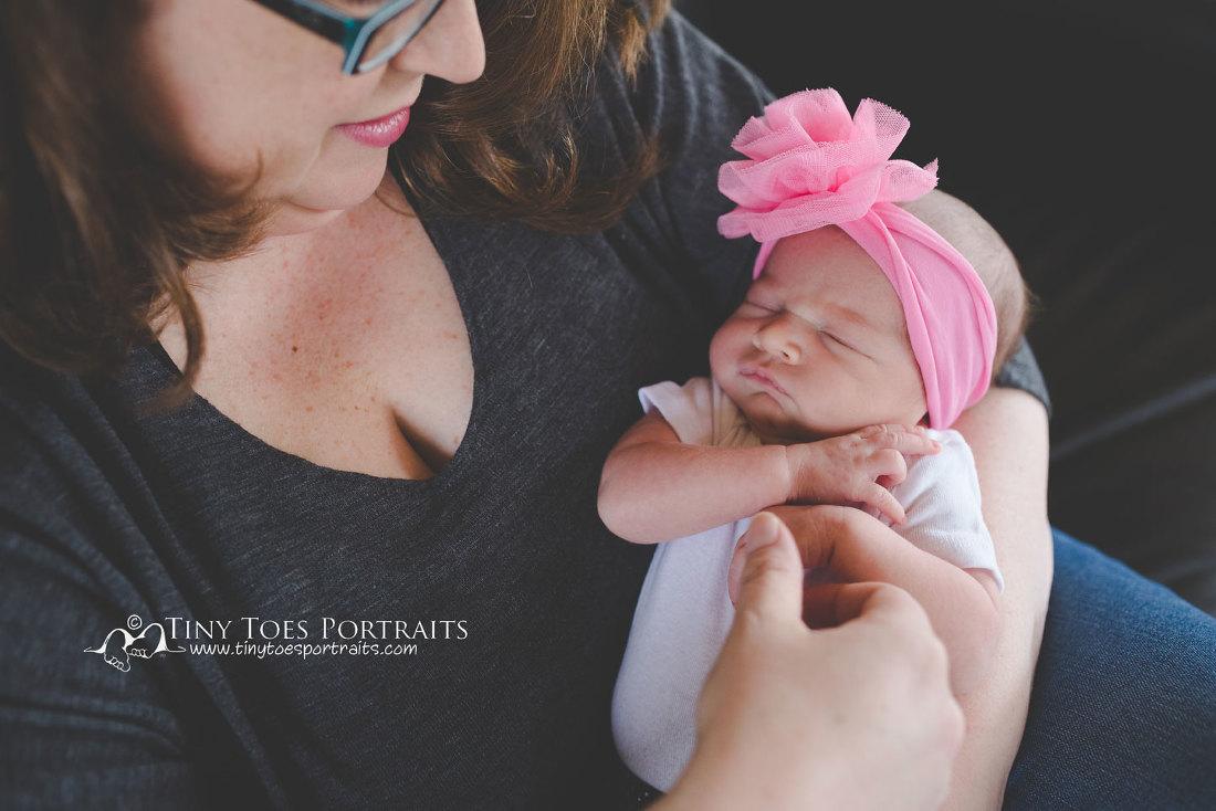 mom holding newborn baby girl