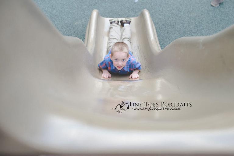 little boy on the slide