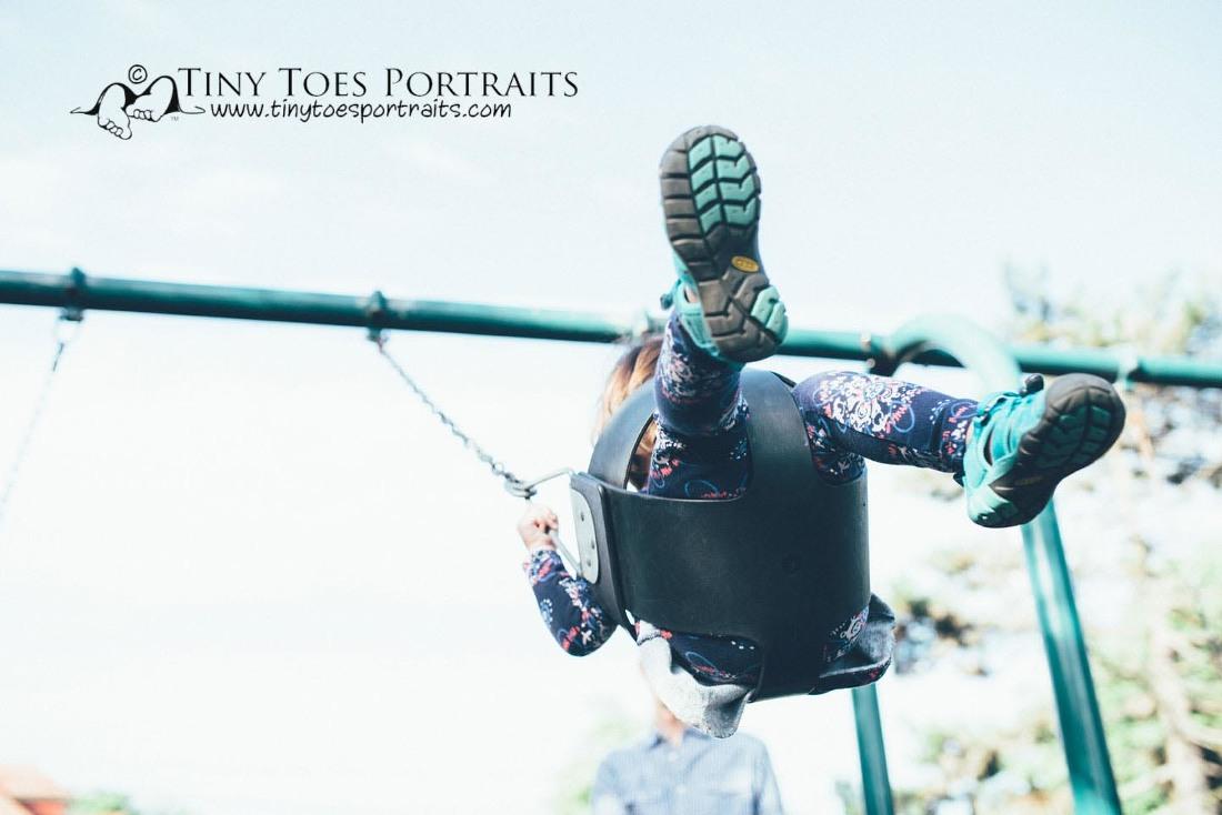 little girl feet on the swings