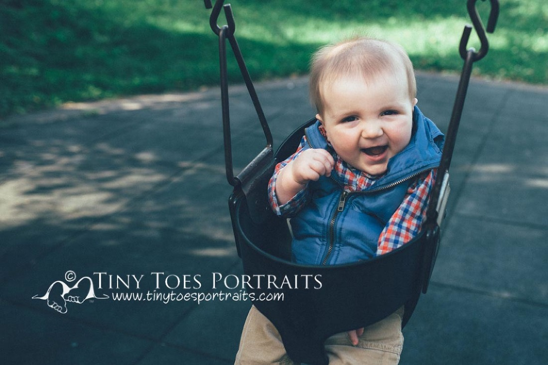 baby boy in the baby swing