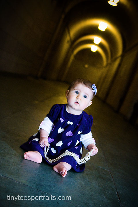 baby girl sitting in the cathedral of learning