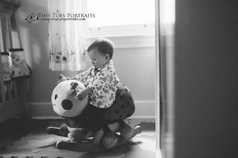 baby girl playing on her rocking horse