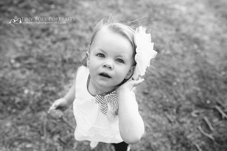 little girl in black and white looking at the camera