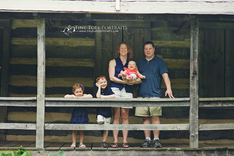 family of five standing on a porch