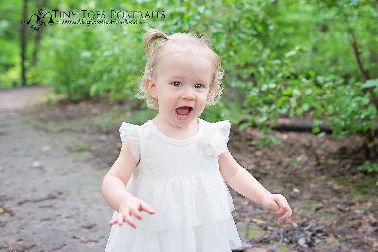 baby girl looking at the camera