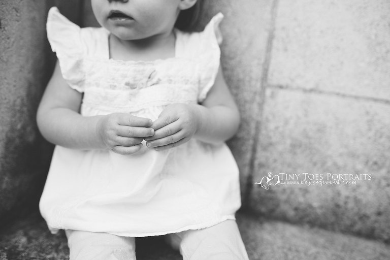 baby girl's hands in black and white