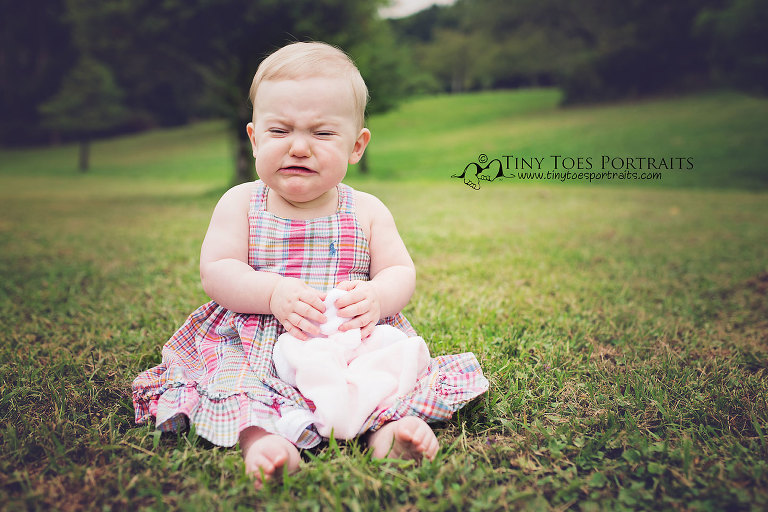 baby girl crying in the grass