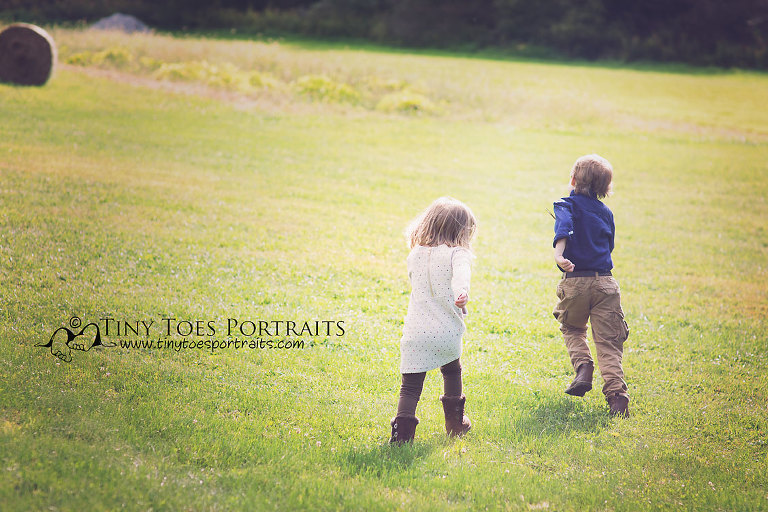 two children running in the grass