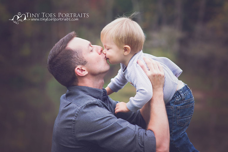little boy kissing his dad