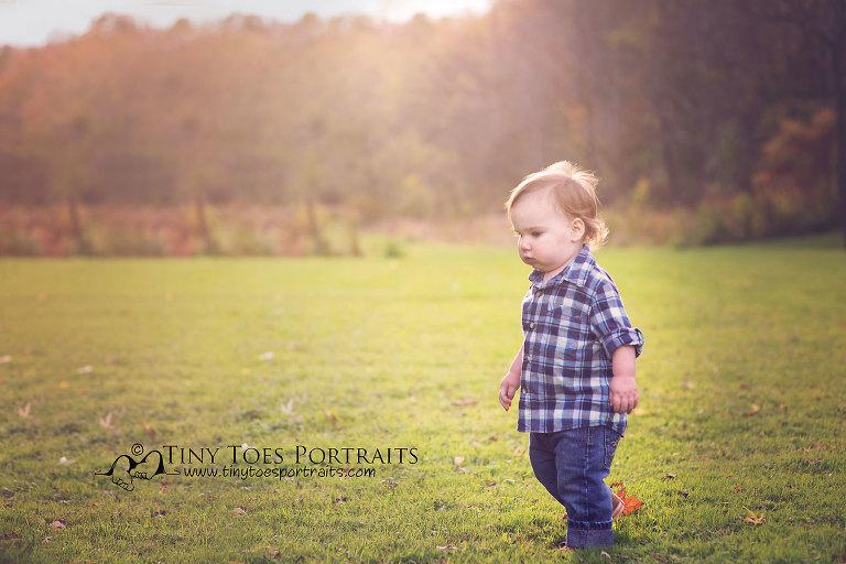 baby boy in a field