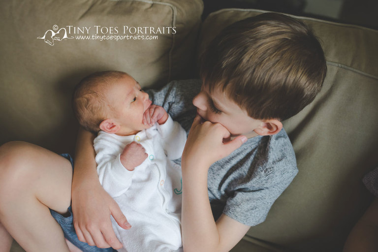 brother imitating newborn brother